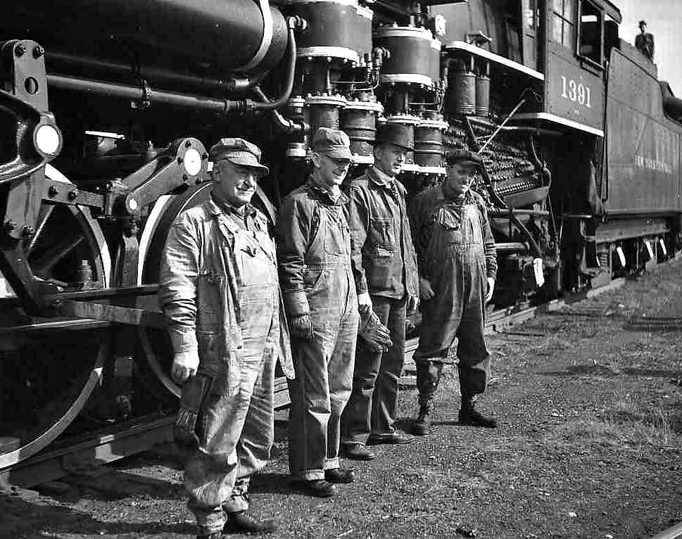 photo of men standing by train
