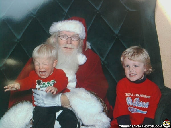 photo of santa with crying child