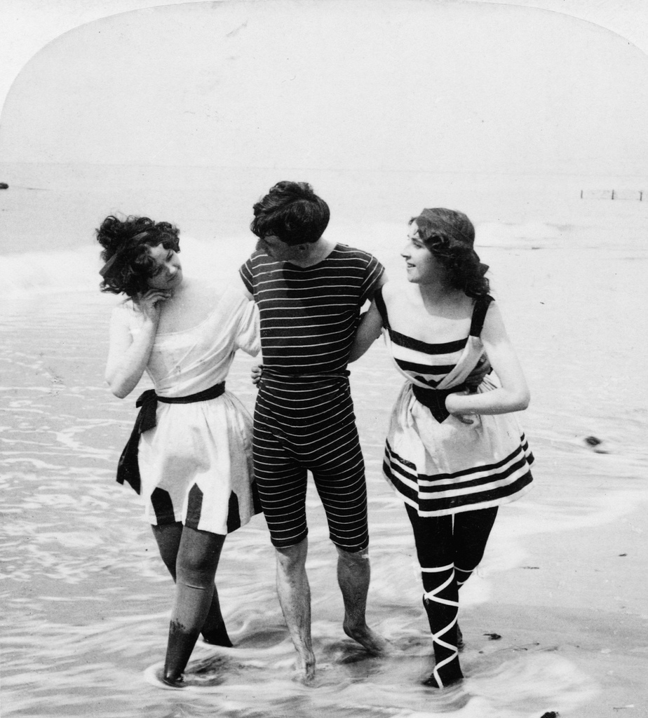 photo of people standing in ocean